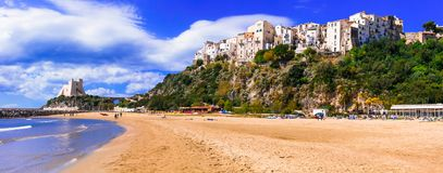 Italian summer holidays - beautiful Sperlonga town with beautiful beaches royalty free stock photos