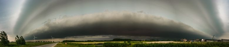 Panorama of an impressive shelf cloud over the western part of The Netherlands royalty free stock images