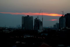 Impressive sunset afterglow over the constructing site in Bangkok. Thailand Stock Photography
