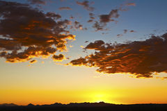Impressive sunset in the desert Royalty Free Stock Photos
