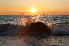 Beach waves hitting the rocks with sunset background at Erimitis beach Paxos island Greece royalty free stock photography