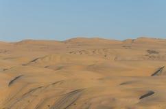 Impressive towering Namib Desert sand dunes of Angola and Namibia. With blue sky Stock Photos
