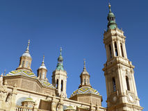 Impressive Towers and Domes of Cathedral-Basilica of Our Lady of the Pillar under Vibrant Blue Sky, Zaragoza Royalty Free Stock Photo