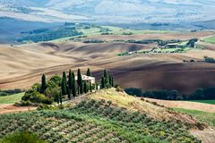Spectacular view with italian autumn vineyard fields in tuscany. Impressive Tuscany view with farm vineyard fields and house. Colorful fall season at Italian royalty free stock images