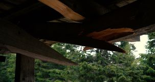 Old wooden roof is broken and needs repair in the Carpathians in slo-mo stock video