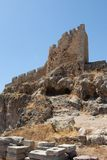 Ruins of an historic building at the Acropolis of Lindos. This is an impressive view upstairs to the ruins of the ancient castle of knights at the Acropolis of royalty free stock photography