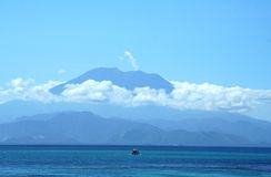 Impressive volcano above the ocean Stock Photo