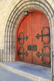 Impressive wood doors under stone archway Stock Image