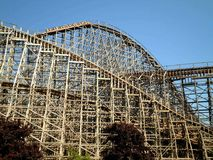 Impressive Wooden Coaster. Impressive wooden roller coaster in amusement park royalty free stock photography