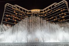 Wynn palace macau, nightitme fountain, water feature with large water jets. Impressive wynn palace resort hotel with the impressive musical fountain, white Royalty Free Stock Images