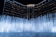 Wynn palace macau, nightitme fountain, water feature with large water jets. Impressive wynn palace resort hotel with the impressive musical fountain, white Royalty Free Stock Photos