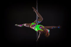 Impressive young pole dancer posing at camera Stock Photography