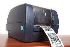 Imprimante de label de code barres Image stock