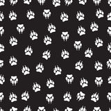 Imprint animal paws with claws, footprint seamless pattern,  vector background, black and white illustration, monochrome Stock Photos