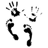 Imprint of hands and feet Royalty Free Stock Images