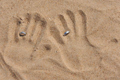 An Imprint of Hands in the Sand with Rings. Stock Photography