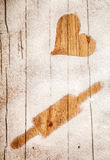 Imprint of a heart and rolling pin in flour Royalty Free Stock Photos