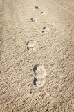 Imprint of the shoe on sand Stock Photos