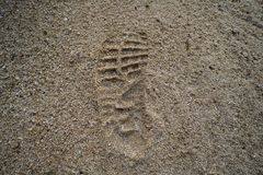 Imprint of the shoe on sand. Grain royalty free stock photo
