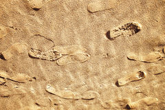 Imprint of the shoes on sunny beach sand Royalty Free Stock Photos