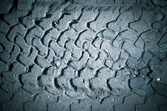 The imprint of the tire on wet sand. Toned Royalty Free Stock Image