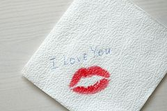 Imprint or A Trace from a Kiss, Red Lipstick on a White Napkin. royalty free stock image