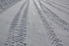 Imprint of a truck tire on the snowy road in winter stock images
