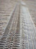 imprints det sandiga gummihjulet Arkivfoton