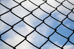 Imprison. Silhouette of Grille with blue sky royalty free stock photos