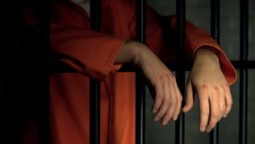 Free Imprisoned Man With Wounds On Arms Standing Near Bars, Incarceration After Fight Royalty Free Stock Image - 156631416