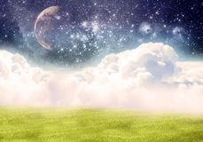 Improbable field. Clouds, space, the moon Royalty Free Stock Image
