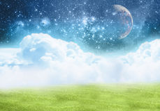 Improbable field. Clouds, space, the moon Royalty Free Stock Photo