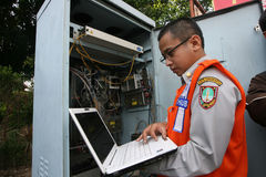 Improve CCTV network. Officers transportation agencies improve CCTV network to monitor traffic flow in the city of Solo broken, central Java, Indonesia Stock Photo