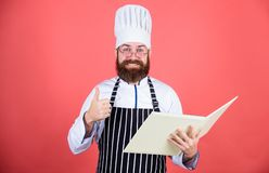 Improve cooking skill. Book recipes. According to recipe. Man bearded chef cooking food. Culinary arts concept. Amateur. Cook read book recipes. Man learn royalty free stock photography