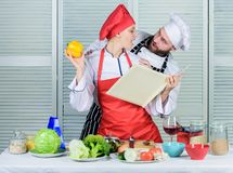 Improve cooking skill. Book recipes. Helpful culinary book. Woman chef and man cooking food together. Culinary family. Improve cooking skill. Book recipes stock image