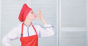 Improve culinary skill. Welcome to my culinary show. Woman pretty chef wear hat and apron. Uniform for professional chef royalty free stock image