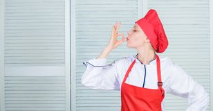 Improve culinary skill. Welcome to my culinary show. Woman pretty chef wear hat and apron. Uniform for professional chef royalty free stock photos