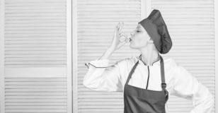 Improve culinary skill. Welcome to my culinary show. Woman pretty chef wear hat and apron. Uniform for professional chef stock photo