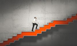 Improve my self. Businessman climbs the stairs,concept of improvement royalty free stock images