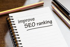 Improve SEO Ranking. Text as memo on notebook stock photo