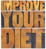 Improve your diet. Healthy lifestyle concept - isolated text in vintage letterpress wood type Royalty Free Stock Photos