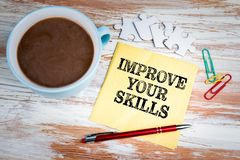 IMPROVE YOUR SKILLS concept. Text on a napkin. With a cup of coffee royalty free stock photography