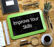 Improve Your Skills on Small Chalkboard. 3D. Royalty Free Stock Photo