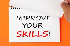 Improve Your Skills. Written on notebook. Hand turn page stock photos
