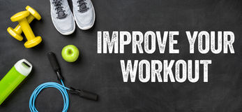 Improve your workout. Fitness equipment on a dark background - Improve your workout Royalty Free Stock Photos