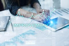 Improvement graph on virtual screen. Business and technology concept. Improvement graph on virtual screen. Business and technology concept Royalty Free Stock Photography