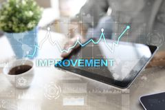 Improvement graph on virtual screen. Business and technology concept. Improvement graph on virtual screen. Business and technology concept Royalty Free Stock Image