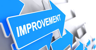 Improvement - Text on Blue Arrow. 3D. Royalty Free Stock Images