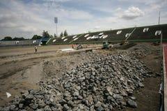 Improves football stadium. Workers improving foootball stadium facility in Manahan, Stadium, Solo, central java, indonesia Royalty Free Stock Photo