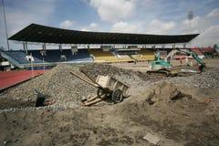 Improves football stadium. Workers improving foootball stadium facility in Manahan, Stadium, Solo, central java, indonesia Stock Photo